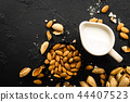 Almond milk in jug. Almond milk and almonds 44407523