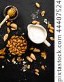 Almond milk in jug. Almond milk and almonds 44407524
