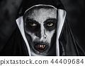 frightening evil nun with bloody teeth 44409684