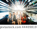 Celebration in a limo, woman and men drinking champagne 44409819