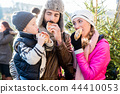 Family eating rolls and sausage on Christmas Market 44410053