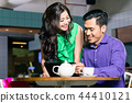 Beautiful woman looking with love at her friend in a coffee shop 44410121