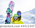 Photo of sporty woman and man with snowboard against backdrop of mountains 44412347