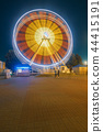 Night amusement park with a ferris wheel 44415191