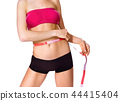 measuring slim body of woman 44415404