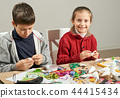 Childrens making decorations for new year holiday 44415434