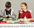 Childrens making decorations for new year holiday 44415435