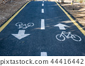 Bicycle sign on the road used for pedestrian cross 44416442