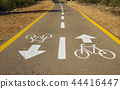 Bicycle sign on the road used for pedestrian cross 44416447