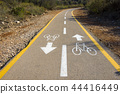 Bicycle sign on the road used for pedestrian cross 44416449