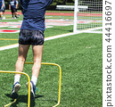 High school girl jumping over two foot hurdles 44416697
