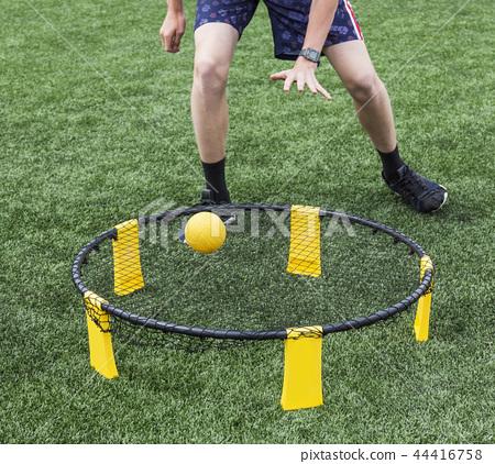 Playing spike ball 44416758