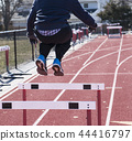 Jumping over hurdles in winter 44416797