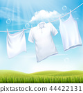 Washing white clothes hanging on the rope.  44422131