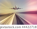 Airliner over highway on blurred background 44422718