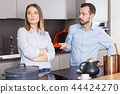 Spouses quarrelling in kitchen 44424270