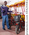 African-American young man offering cycle rickshaw service 44424481