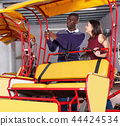 Woman talking with successful African American driver of pedicab 44424534