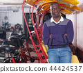 African-American young man rickshaw cycle driver standing 44424537