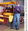 Adult driver of pedicab offering touristic tour 44424603