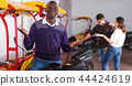 Young driver of pedicab offering touristic tour 44424619