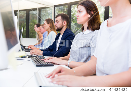 Side view of business men and women coworkers during daily work 44425422