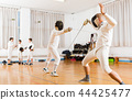 fencing duel of two l athletes in gym 44425477