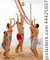 Friends playing volleyball at beach 44425607