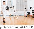instructor, exercising, gloves 44425785