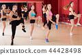 Women dancing in class 44428498