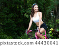 Sporty woman practicing on the bicycle  44430041