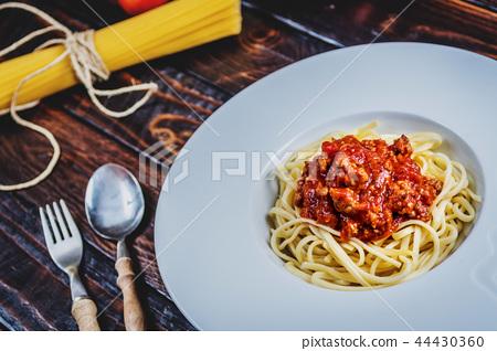 Italian spaghetti bolognesse 44430360
