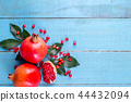 Ripe pomegranate fruits on the wooden background 44432094