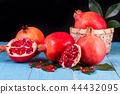 Ripe pomegranate fruits on the wooden background 44432095