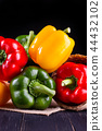 Three sweet peppers on a wooden background, 44432102