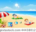 Two boy sunbathing on the beach mat 44438012