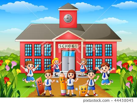Many school children in front of school building 44438045