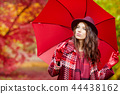 Beautiful woman in autumn park 44438162