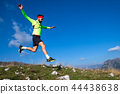 Skyrunner during a downhill jump  44438638