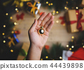 Hand Holding Small Gold Bauble Christmas 44439898