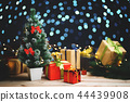 Small Christmas Tree Between Christmas Presents 44439908