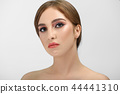 Close up of young brown-eyed woman with perfect evening make up. 44441310