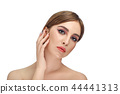 Seductive girl with professional make up, touching her face by fingers. 44441313