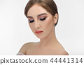 Woman with professional make-up with closed eyes isolated on white background. 44441314