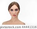 Beautiful girl with professional bright make-up looking at camera. 44441316