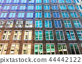 Old and modern architecture contrast background 44442122