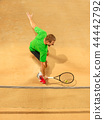 The one jumping player, caucasian fit man, playing tennis on the earthen court 44442792