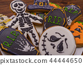 Closeup of Halloween cookies in the form of ghost figures, pumpkins, zombies. Halloween party sweets 44444650