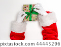 Santa making a Christmas gift 44445296