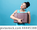 Young woman with a suitcase travel theme 44445388